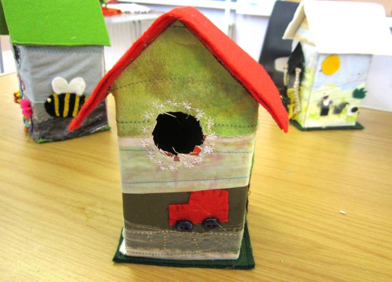 A Bird House with a Red Van.