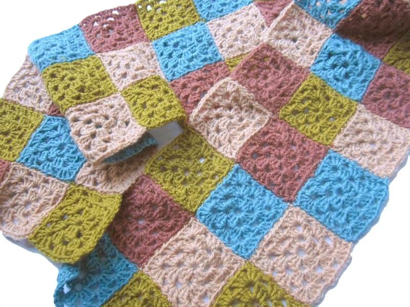 Squares sewn into a scarf.