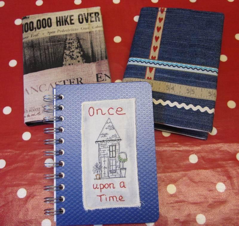 Three fabric covered books.
