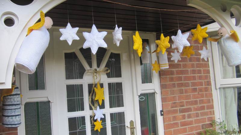 Stars yarn bombing the porch.