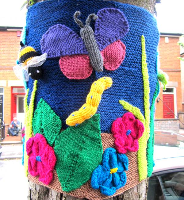 Yarn Bombing trees.