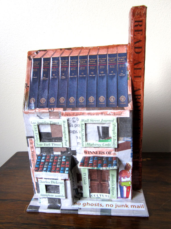 A papier mache house made from paper and glue